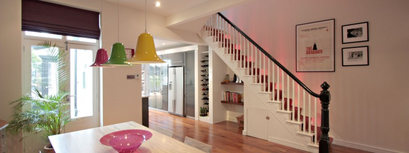 Dining room and staircase decorated by Heaton Decorators